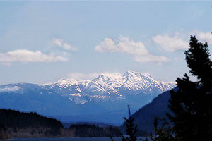 Snowy Mountain Range. Drive to Ocean Mist Guesthouse B&B, Highway 4, Ucluelet, BC